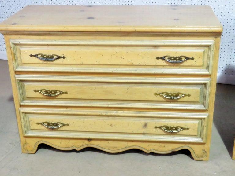 Pair of pine three-drawer commodes.