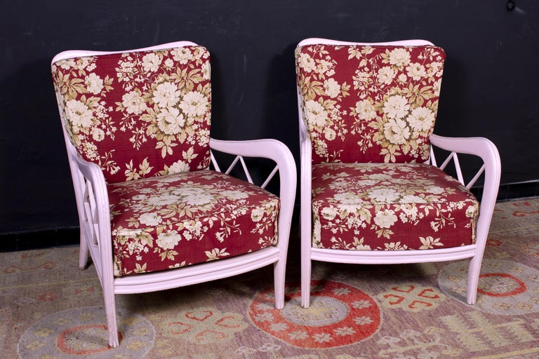 Delicious set of pink painted wood frames lounge chairs or armchairs with deep seat.