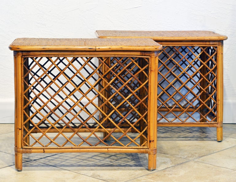This pair of Dominican Republic rattan side tables in the plantation style also have owners metal plagues showing that they once belonged to a fruit plantation. Both chairs also have maker's labels, please see photos.
