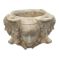 Pair of Planters with Four Candle Holes and Faces on Each Side