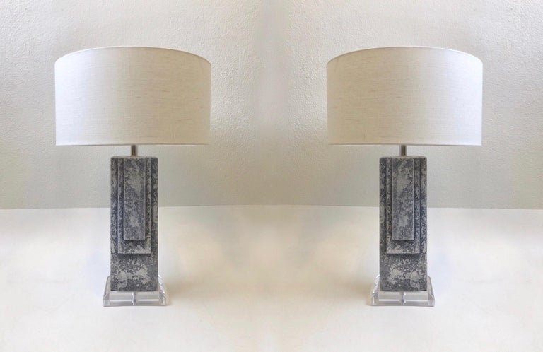 Glamorous 1980s grayish blue plaster table lamps. They are constructed of white plaster with a gray blue wash finish on an acrylic base. Newly rewired with polish chrome hardware and new vanilla linen shades