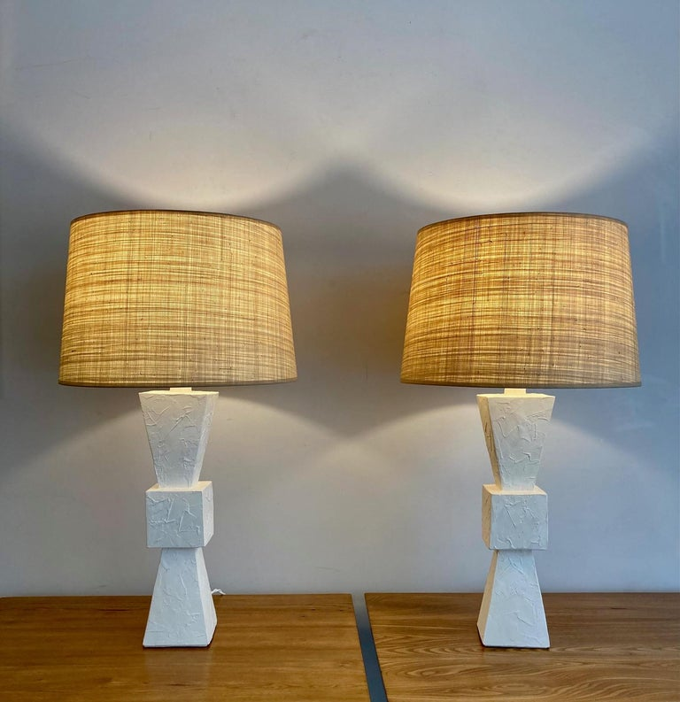Pair of plaster lamps, baluster shape. With custom made shades in vegetal fiber. France, contemporary creation  Measures: Total height 81 cm - 31.9 inches Plaster base height (including collar) 52 cm - 20.5 inches Diameter (shade) 47 cm - 18.5