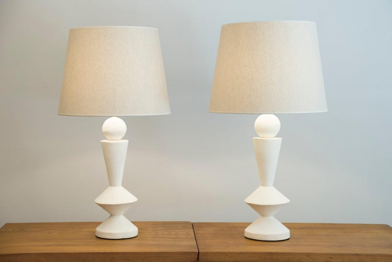 Pair of stuccoed plaster lamps Custom made shades Inspired by Jean-Michel Frank France, modern production  Measures: Height total 84 cm Height plaster foot 48 cm Diameter (shade) 46 cm.