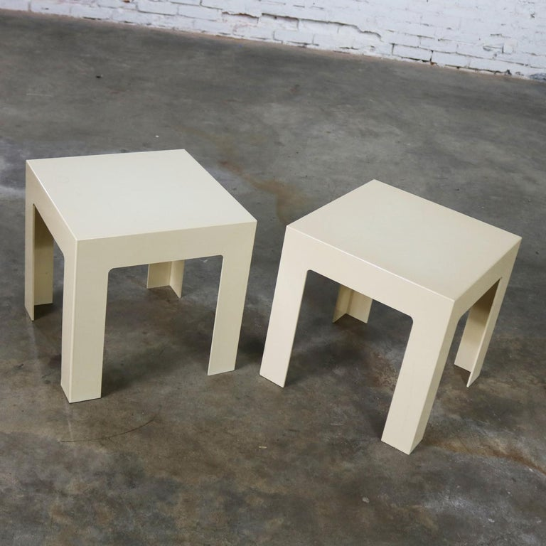Wonderful pair of heavy plastic parsons square side tables. They are both antique white but just a shade different. Done in the style of Kartell or Syroco although unsigned. They are in fabulous vintage condition with normal wear and tear but no