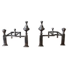 Pair of Polished Iron Andirons in the Art Deco Style