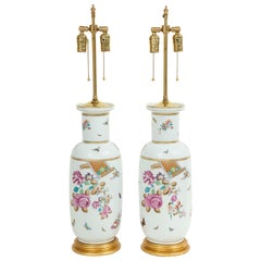 Pair of Porcelain Polychrome and Gilt Rouleau Vase Lamps
