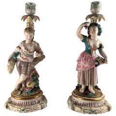 Pair of Porcelain Rococo Style Figural Candlesticks, ca. 1850