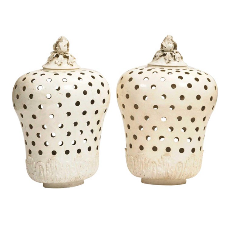 A rare pair of large potpourri jars and covers. Porcelain with a cream glaze. Acanthus leaf decoration around the base, floral tops. France or Italy.