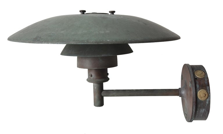 Poul Henningsen design copper wall lamps, model 4,5 /3, manufactured by Louis Poulsen. Incredible paying on these. An iconic lamp brought to the outdoors. Please note: These have been newly re-wired to conform to North American standards.