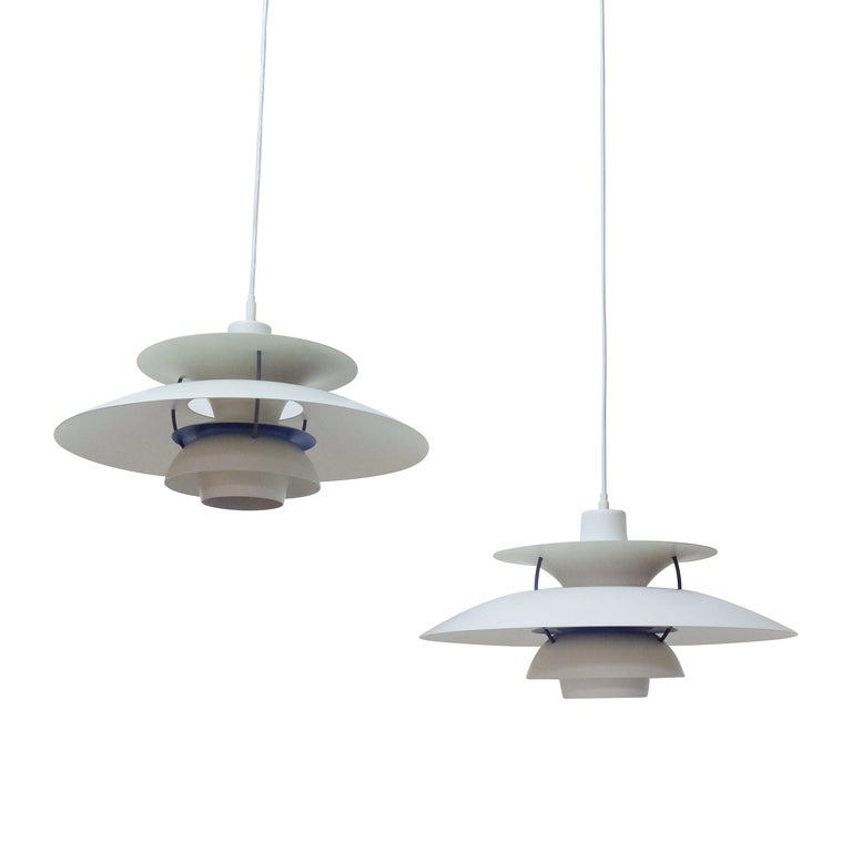 A pair of Poul Henningsen's PH5 ceiling lamps produced by Louis Poulsen, Denmark.  The lamps are in very good condition, no scratches or noticeable signs of wear, they are tested and provided with new wiring.  Price for the pair. We have currently