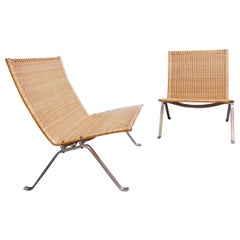 Pair of Poul Kjaerholm 'PK-22' Steel and Wicker Easy Chairs, Fritz Hansen
