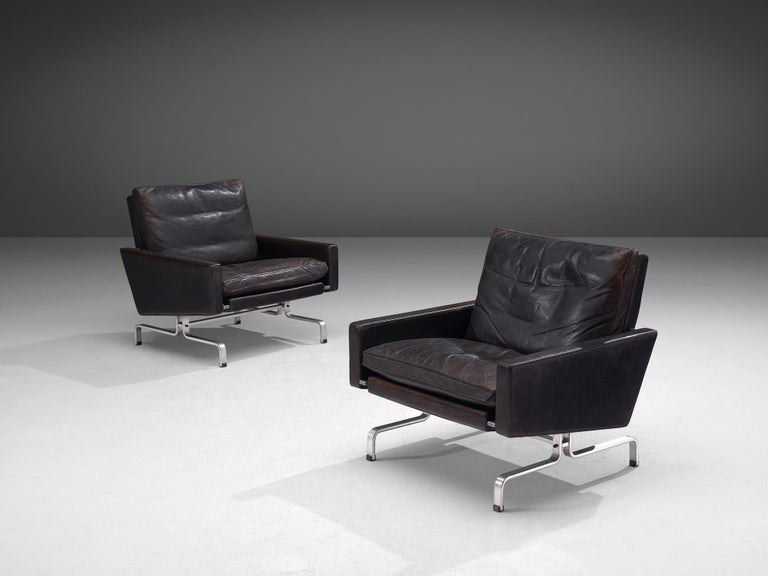 Poul Kjaerholm for E. Kold Christensen, pair of PK 31 lounge chairs, leather and metal, Denmark, 1958.  Beautiful pair of PK31 Lounge chairs in aged black leather by Poul Kjaerholm for E. Kold Christensen. This set of chairs features Poul