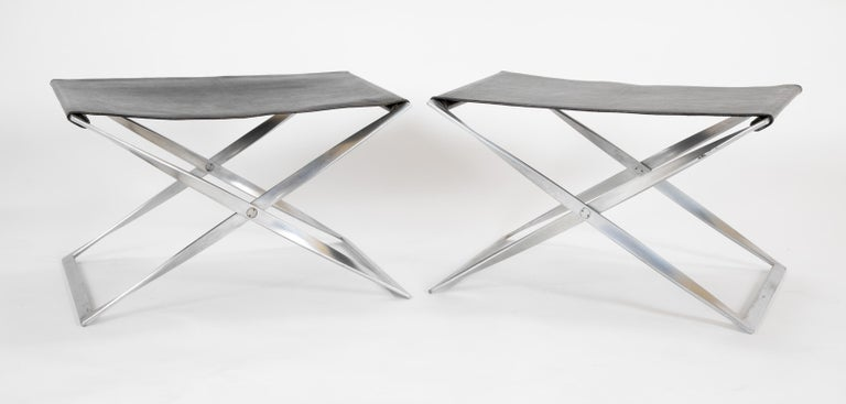 A pair of PK91 stools each stamped EKC inside a square. Please note these are from the first edition of PK91 stools not the latter edition by Fritz Hansen. Matte chrome-plated steel frames with the original goat leather. For illustrated examples