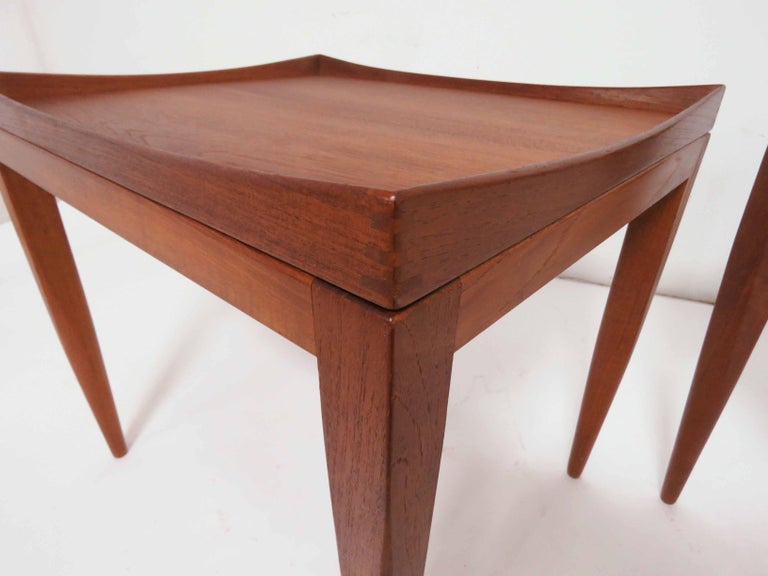 Pair of teak end tables with removable tops, by PMJ (Poul M. Jessen), Denmark, circa 1960s. Exquisite examples of Danish craftsmanship, trays with gently peaked corners and exposed finger joints.