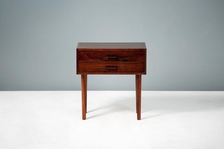 Pair of 1960s vintage rosewood bedside cabinets. Design attributed to Poul Volther & produced in Denmark. Each cabinet has 2 drawers with slanted drawer pulls and turned, tapered legs.