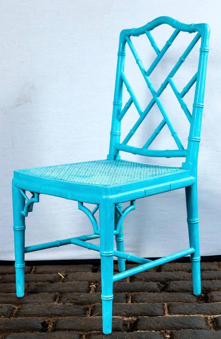 Pair of powder blue armless Chinese Chippendale chairs, carved wood, caned seats. Measures: Seat depth 16.75 inches.