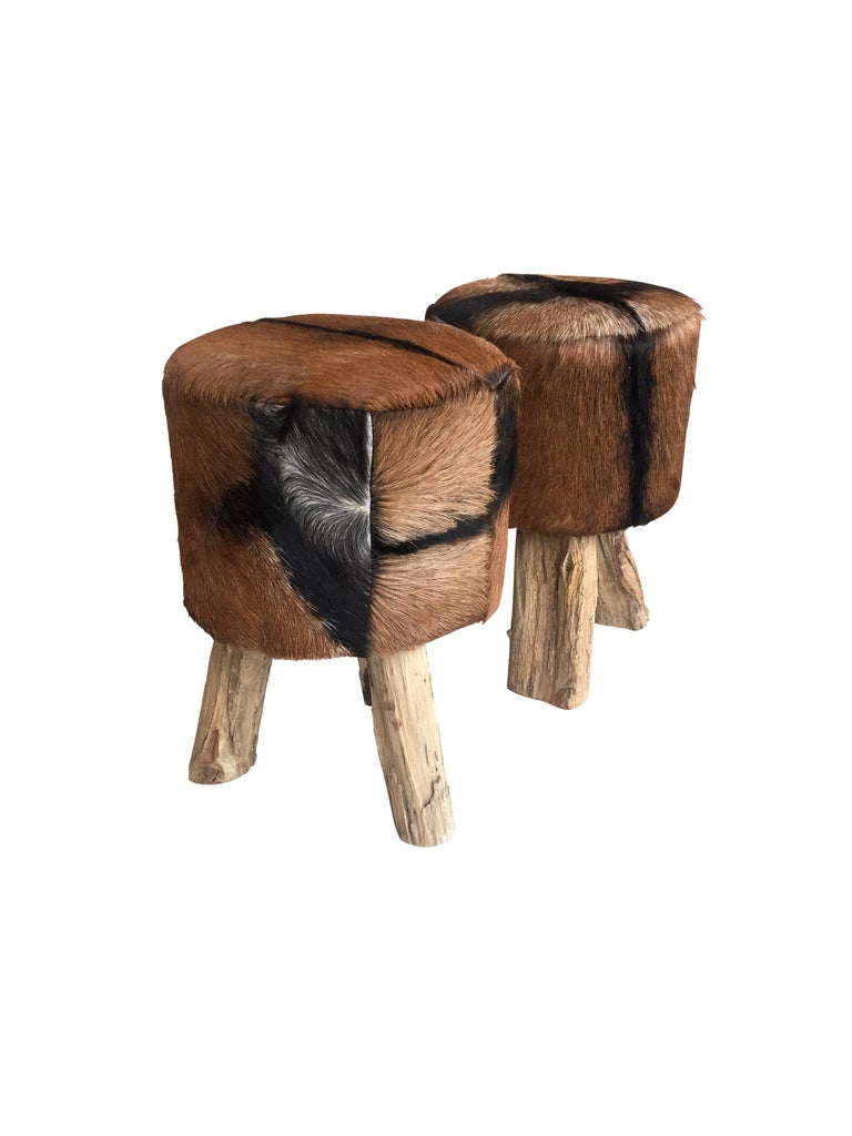 Pair of Primitive Nubuck Hide Stools with Wood Legs In Good Condition For Sale In Chicago, IL