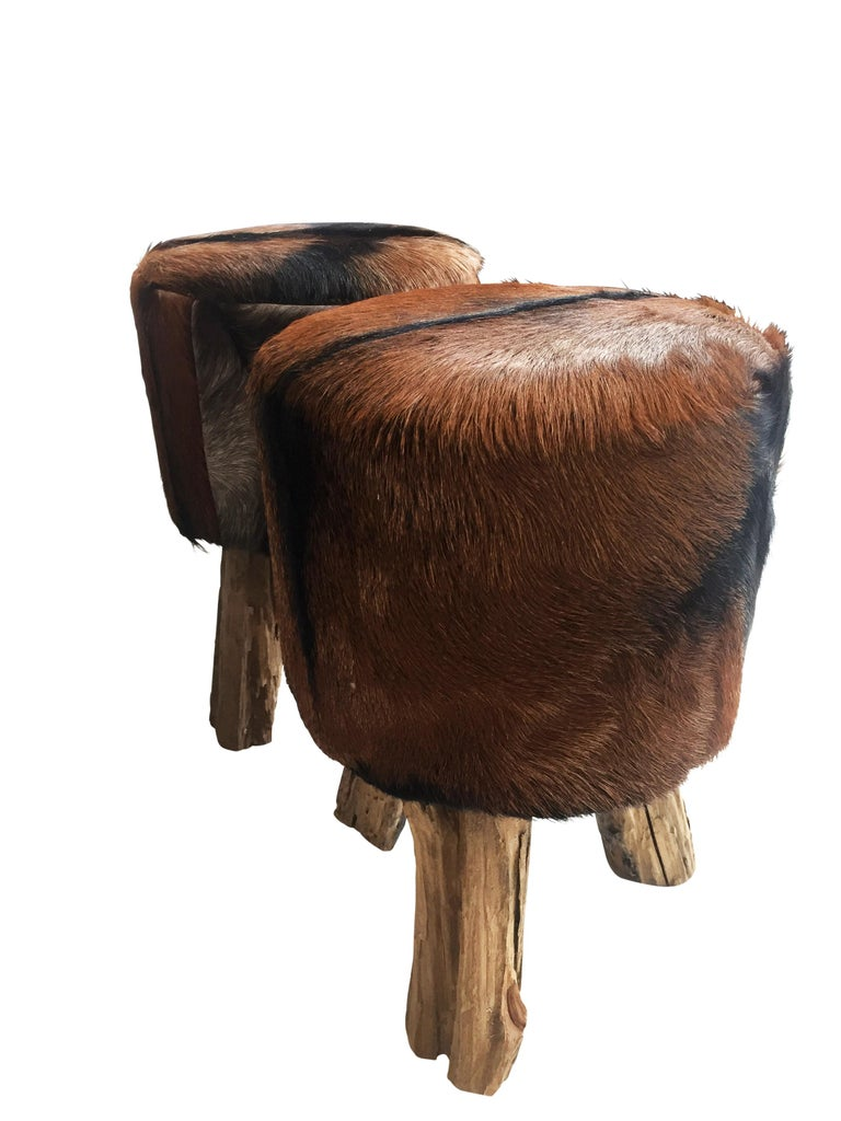 Late 20th Century Pair of Primitive Nubuck Hide Stools with Wood Legs For Sale