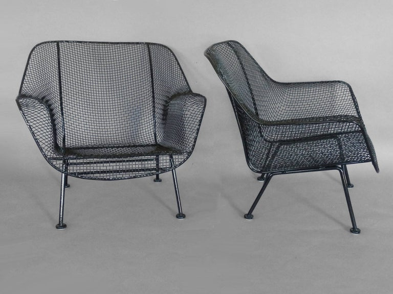 Mid-Century Modern Pair of Properly Restored Black Woodard Wrought Iron with Mesh Lounge Chairs For Sale