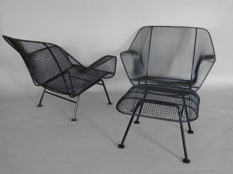 American Pair of Properly Restored Black Woodard Wrought Iron with Mesh Lounge Chairs For Sale