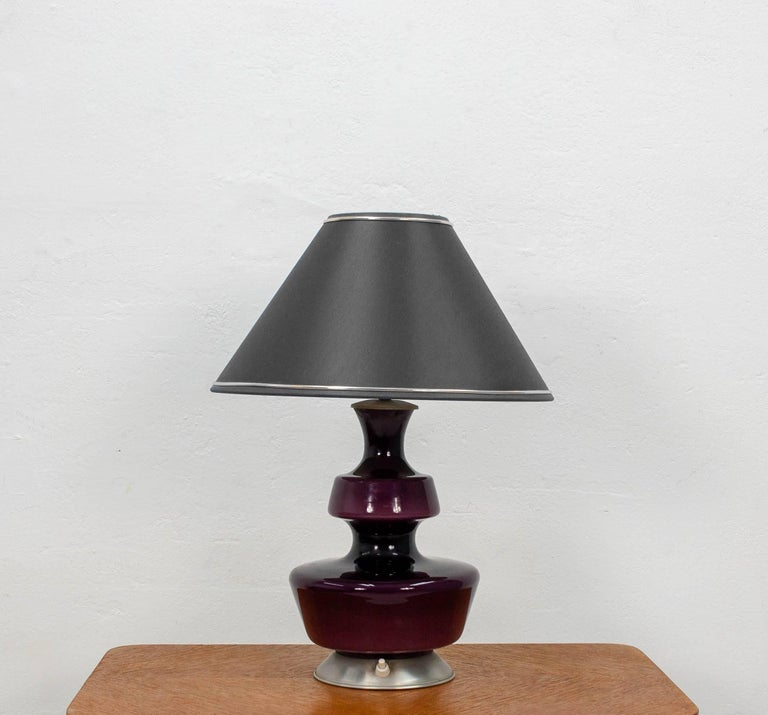Two funky purple opaline glass Holmegaard lamp bases, 1960s. They feature a secondary armature inside the lamp base to illuminate them from within.