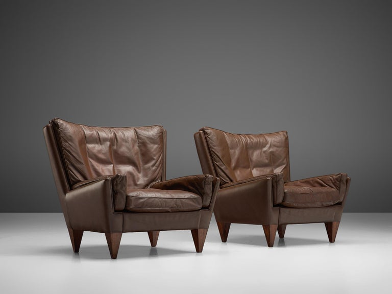 Illum Wikkelso for Holger Christiansen, pair of lounge chairs model V11 'Pyramid,' wood and leather, Denmark, 1960s.
