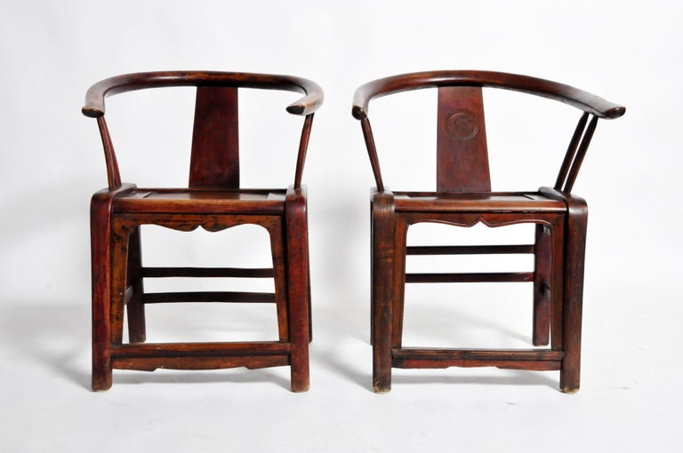 This late Qing dynasty pair of round back chairs are from Shandong, China and were made from
