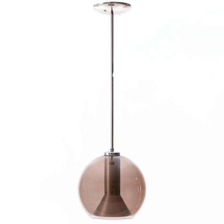 A pair of pendant lights or hanging lamps by Frank Ligtelijn for RAAK Amsterdam, Netherlands, manufactured in midcentury, circa 1960.