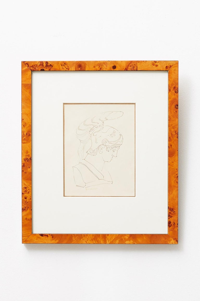 Exquisite pair of Greco-Roman pen and ink drawings by San Francisco artist Ralph DuCasse (1916-2003 American). Both signed on bottom, one of a warrior, and the other of the colosseum in Rome titled Colossed. Each framed in a burl veneered frame