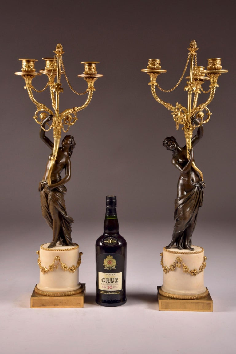 Attributed to François Rémond, a very nice pair of neoclassical patinated bronze and ormolu three branch candelabra, with standing beautiful semi nude nymphs.  Paris, Louis XVI period, circa 1785.