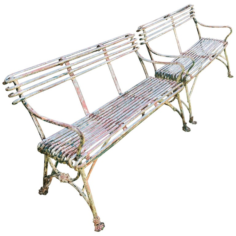 Pair of French wrought-iron Arras benches, mid-19th century, offered by The Elemental Garden, LLC