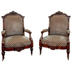 Pair of Rare and Fine Victorian Heavily Carved Armchairs