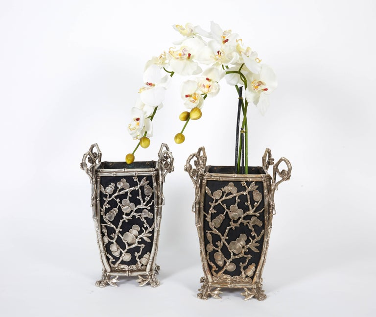 Pair of rare French Japonisme silvered bronze cachepots or vases, circa 1890.  Beautiful pair of cachepots, with acorn feet, decorated with cranes. Original liners.  Excellent condition.  12