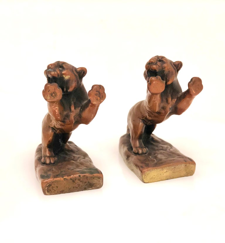 Rare pair of collectible roaring galvanic bronze bookends, circa 1920s in original patinated condition Prior to 1914 just about all high-end sculptural artwork was solid bronze. About that time a company called Kathodian Bronze Works began