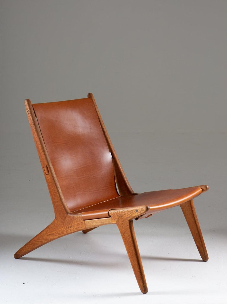 Pair of rare lounge chairs model 204 by Uno & O¨sten Kristiansson for Luxus, Sweden. The hunting chair was designed by Uno and O¨sten Kristiansson in 1954 and belongs at the top of Swedish design history. The chair features a frame in oak and a