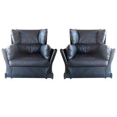 Pair of rare leather armchairs by Piero de Martini for Cassina