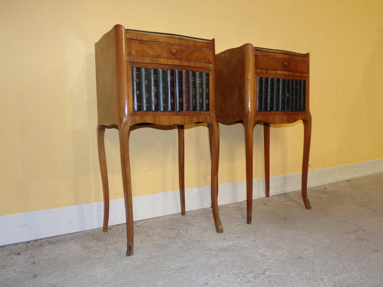 An unusual pair of bedside cabinets with