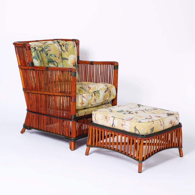 Pair of vintage rattan or stick wicker armchairs and ottomans with a casual elegance that invites comfort. Featuring reed wrapped construction and remarkable preserved period upholstery.