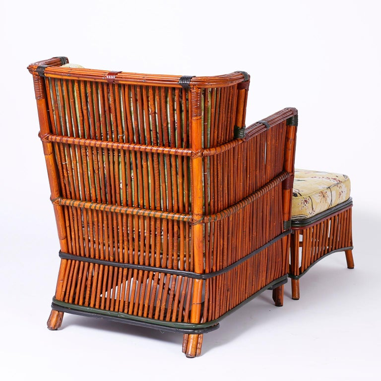 Woven Pair of Rattan Armchairs with Ottomans For Sale
