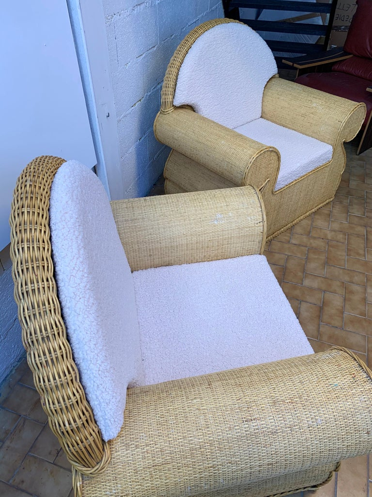 Large pair of rattan wicker armchairs or lounge chairs style club. New upholstery with a bouclé fabric. In the style of Vivai del Sud, Tito Agnoli, Hollywood Regency.
