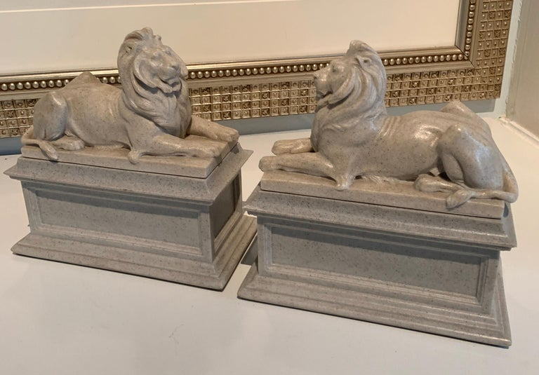 A pair of reclining lion bookends, a stunning pair with the look of limestone, but a composition material. The pair are of good weight for those larger books... looking great on any shelf or desk.
