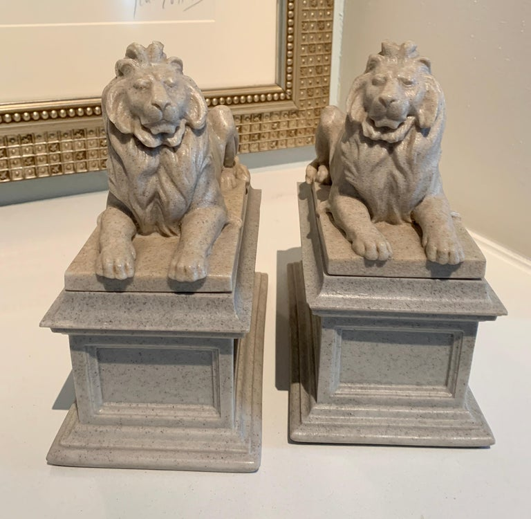 Molded Pair of Reclining Lion Bookends For Sale