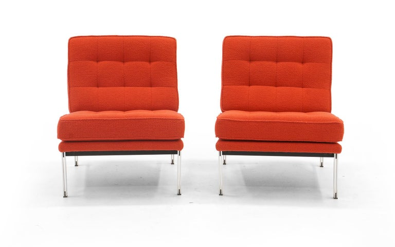 Pair of armless lounge chairs design by Florence Knoll for the Parallel Bar Series for Knoll. These have been expertly reupholstered in crimson Knoll classic boucle. The chromed steel frames date from the 1960s.
