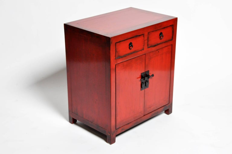 Elm Pair of Red Lacquered Chinese Side Chests with Two Drawers and a Shelf For Sale