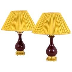 """Pair of Red """"sang-de-bœuf"""" Porcelain Lamps, 19th Century"""