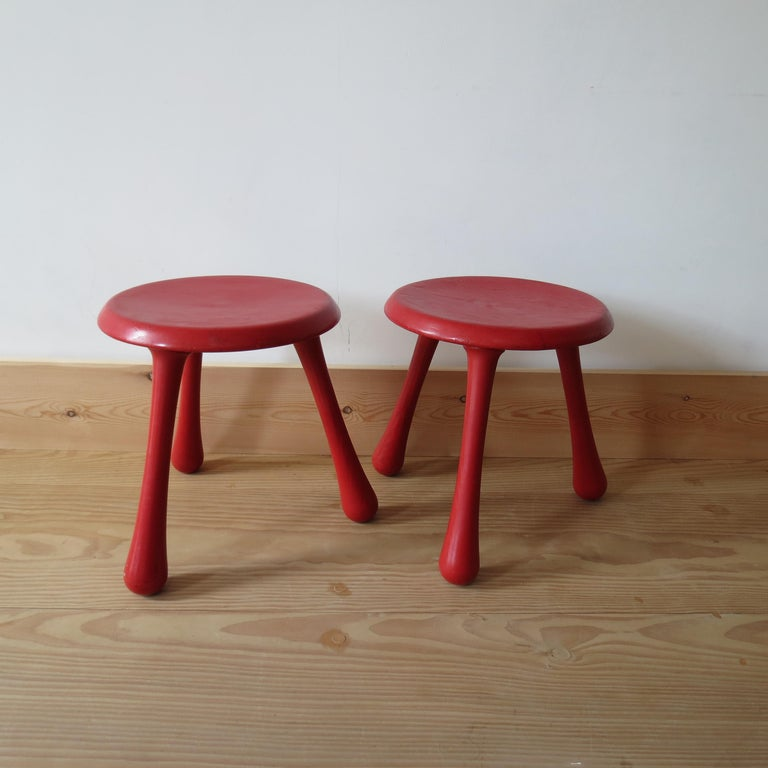 Pair of red stools, designed by Ingvar Kamprad and produced by Habitat. Designed in 2004, this pair of stools are in good vintage condition with some signs of wear to the finish. 