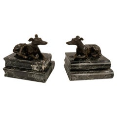 Pair of Regency Bronze Figures of Reclining Whippets on Green Marble Bases