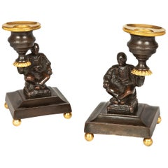 Pair of Regency Bronze and Gilt Brass Candlesticks depicting seated Chinamen