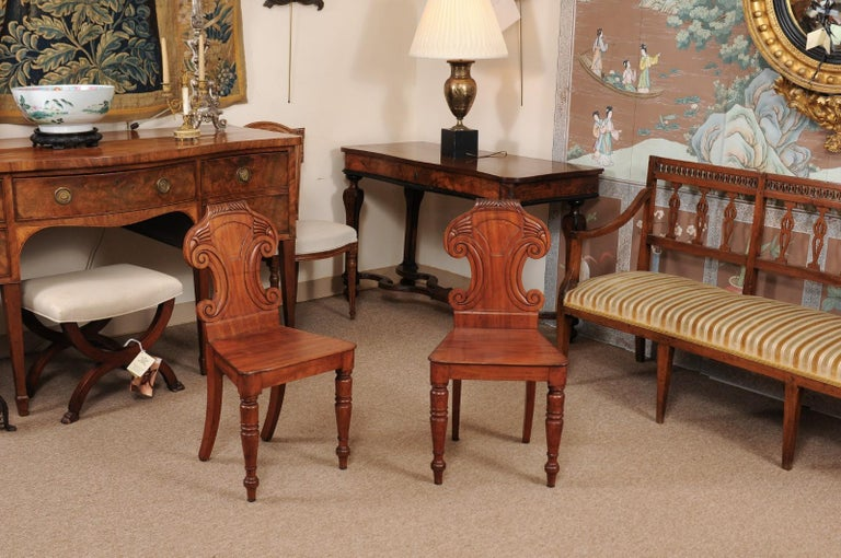 Hand-Carved Pair of Regency English Mahogany Hall Chairs, circa 1810 For Sale