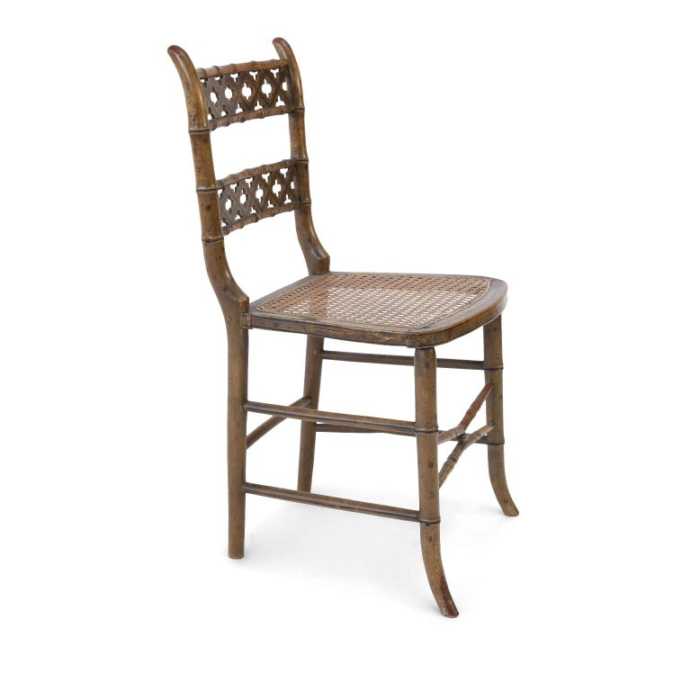Pair of Regency faux bamboo chairs in original paint. Hand carved (circa 1810-1830) with quatrefoil and painted line decoration along back. Sold together and priced $2,900 for the pair.